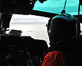A U.S. Coast Guardsman aboard an MH-65 Dolphin helicopter assigned to Coast Guard Air Station Los Angeles and embarked aboard maritime security cutter USCGC Bertholf (WMSL 750) identifies ice floating in 120828-G-VS714-027.jpg