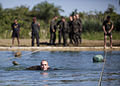 A U.S. Marine with Company A, 2nd Assault Amphibian Battalion, attached to Special-Purpose Marine Air-Ground Task Force Continuing Promise 2010 performs Guatemalan army special operations forces swimming 100907-M-PC721-178.jpg