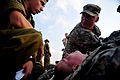 A U.S. Soldier with simulated wounds is treated by U.S. Army and Israel Defense Forces medics during a medical exercise for Austere Challenge 2012 in Beit Ezra, Israel 121022-F-QW942-101.jpg