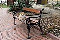 A cat sitting on a bench, Varna, December, 2018.jpg