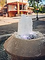 A fountain at town center of a small town (51169692328).jpg