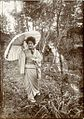 A girl walking through the woods in Miyanoshita, Japan (c. 1907).jpg