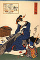 A seated woman sewing a kimono.jpg