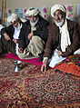 A village elder speaks to members of the Afghan Local Police (ALP) during a shura, or meeting, in Shah Joy district, Zabul province, Afghanistan, Feb 120211-N-CI175-166.jpg