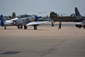 A wing walker guides an LT-6D Mosquito, courtesy of the Dixie Wing of the Commemorative Air Force, to a parking space on the flightline after a rehearsal for the installations Super Saturday Air Show 120810-A-ZT847-522.jpg