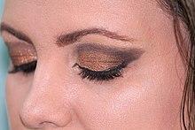 Eyes with heavy gold eye shadow