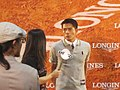 Aaron Kwok with Hong Kong Cable Television microphone 20110513.jpg