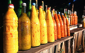 Bottles of yellow and orange sauce
