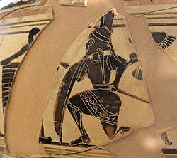 More pottery fragments. An armoured man kneels, hiding behind the structure.
