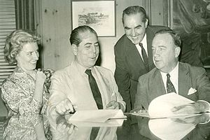 María Amalia Lacroze de Fortabat - Mrs. Fortabat joins her husband (2nd from left) in a 1959 business meeting.
