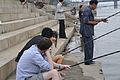 Americans fishing the local North Korean way (10058606876).jpg