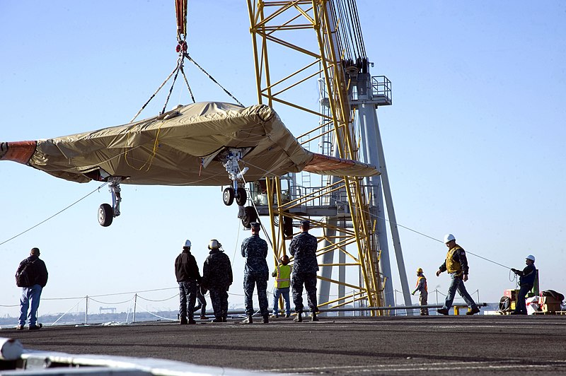 File:An X-47B unmanned combat air system (UCAS) demonstrator is hoisted aboard the aircraft carrier USS Harry S. Truman (CVN 75) in Norfolk, Va., Nov. 26, 2012.jpg
