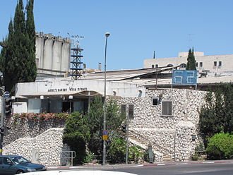 """Angel Bakeries - The landmark Angel's Bakery factory store in Givat Shaul. The light board with the number """"62"""" indicates 62 years since the establishment of the State of Israel."""