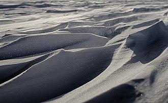 Sastrugi - Wind sculpted snow near South Pole Station, forming sastrugi features.