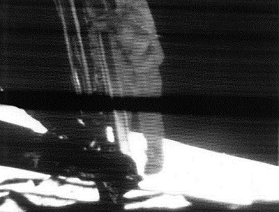 Still frame from the video transmission of Neil Armstrong stepping onto the surface of the Moon on 20 July 1969. An estimated 500 million people worldwide watched this event live, the largest television audience for a live broadcast at that time.