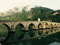 Aqueduct on a river (Unsplash).jpg