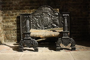 Cast iron - Pair of English firedogs, 1576. These, with firebacks, were common early uses of cast iron, as little strength in the metal was needed.