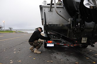 Naval militia - An officer with the New York Naval Militia prepares his vessel for transport.