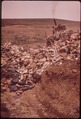 BOULDER COUNTY'S LANDFILL DUMP. SOLID WASTE IS DUMPED INTO TRENCHES AND COVERED IMMEDIATELY - NARA - 543828.tif