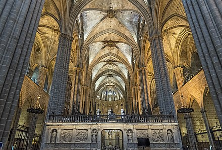 Barcelona Cathedral has a wide nave with the clerestory windows nestled  under the vault.