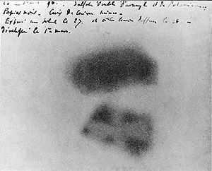 Henri Becquerel - Image of Becquerel's photographic plate which has been fogged by exposure to radiation from a uranium salt. The shadow of a metal Maltese Cross placed between the plate and the uranium salt is clearly visible.