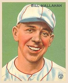 A baseball-card image of a smiling man in a white baseball uniform and cap