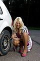 Blond woman changing a tire.jpg