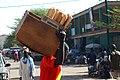 Boutiquier transportant du pain.jpg