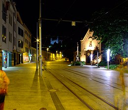 Street with tram tracks at night
