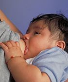 An infant breastfeeding
