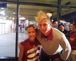 Brek Shea (right) posing with a fan.