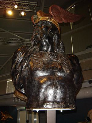 Winged helmet - A 19th century ship's figurehead depicting Brennus wearing a winged helmet