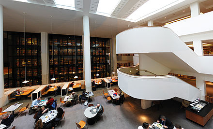 Interior of the British Library, with the smoked glass wall of the King's Library in the background. BritishLibraryInterior02.jpg