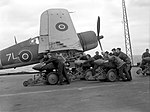 British naval personnel moving bombs before a raid during Operation Goodwood.jpg