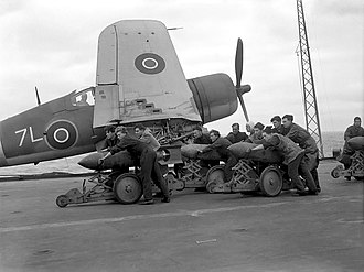 "Operation Goodwood (naval) - British sailors moving bombs along the deck of an aircraft carrier prior to ""bombing up"" Baracudas for one of the raids conducted during Operation Goodwood"