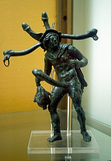Polyphallic bronze tintinnabulum; the tip of each phallus was outfitted with a ring to dangle a bell Bronze ithyphallic figurine with a head of phalluses.jpg