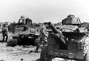 Battle of Hannut - Two destroyed SOMUA S35s being inspected by German soldiers.