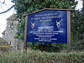 Bush End, Essex, England ~ St John Evangelist exterior ~ church sign board.jpg