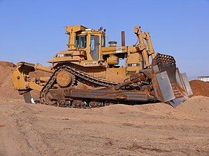 Bulldozer - A Caterpillar D10N bulldozer equipped with a single shank ripper.