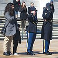 CSM Brenda Curfman Retirement Wreath Laying - salute with family (16334534900).jpg