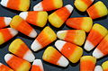 Candy corn strewn on a black background.jpg
