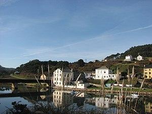 Casas en la orilla del Masma.jpg