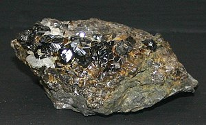 Tin - Sample of cassiterite, the main ore of tin.