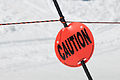 Caution sign on ski slope.jpg