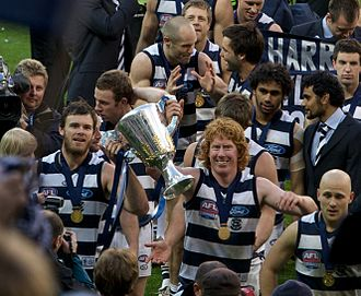 Geelong Football Club - Cameron Mooney and Cameron Ling holding the 2009 premiership cup