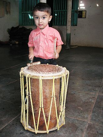 Folk arts of Karnataka -  Various styles of traditional drums are used in folk music, dance and theater of Karnataka
