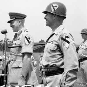 William C. Chase - Major General William C. Chase (right) inducts Lieutenant General H. C. H. Robertson (left), Commander in Chief British Commonwealth Occupation Force (BCOF), as an honorary member of the 1st Cavalry Division.
