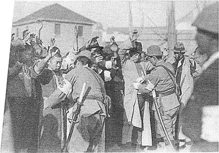 Japanese soldiers searching Chinese men for weapons Check of Chinese soldiers in Nanking01.jpg