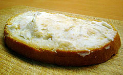 A slice of bread spread with lard was a typical staple in traditional rural cuisine of many countries.