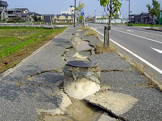 Soil liquefaction - Liquefaction allowed this sewer to float upward – 2004 Chūetsu earthquake